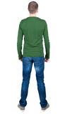 Back view of young man in t-shirt and jeans  looking. Royalty Free Stock Photography