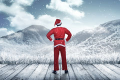 Back view of young man wearing santa claus costume Stock Images
