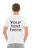 Back view of young man in white t-shirt with. Your text here isolated on white background Stock Photo