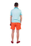 Back view of young manin shorts looking. Stock Photography