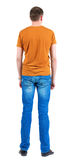 Back view of young men in  orange t-shirt. Royalty Free Stock Images