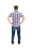 Back view of young men in shirt and jeans Stock Image