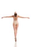 Back view of young modern ballet dancer isolated on white background. Young modern ballet dancer posing on white background. back view Royalty Free Stock Photos