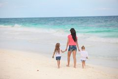 Back view of young mother and her cute daughters Royalty Free Stock Images