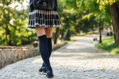 Back view of a young school girl carrying backpack royalty free stock photos