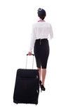 Back view of young stewardess walking with suitcase isolated on Royalty Free Stock Photos