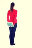 Back view of young student woman. Royalty Free Stock Photo