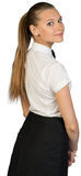 Back view of young waitress looking at camera Royalty Free Stock Photography