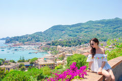 Back view of young woman background stunning town. Tourist looking at scenic view of Cinque Terre, Liguria, Italy royalty free stock images