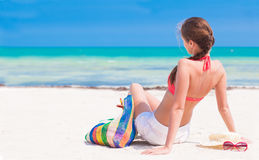 Back view young woman in bikini and sunglasses Royalty Free Stock Images