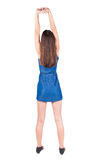 Back view of young woman limber up. Royalty Free Stock Photography