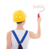 Back view of young woman painter in workwear with paintbrush iso Stock Photo