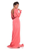 Back view of a young woman in a pink gown Royalty Free Stock Image