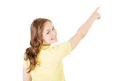 Back view young woman pointing up to the corner.  Royalty Free Stock Photos