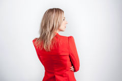 Back view of young woman in red jacket Stock Photos