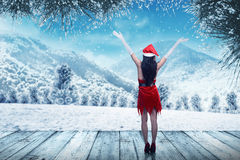 Back view of young woman wearing santa claus costume Royalty Free Stock Photo