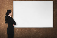 Back view young woman with white board Stock Images