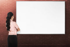 Back view young woman with white board Royalty Free Stock Photo