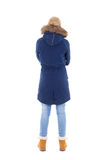 Back view of young woman in winter clothes isolated on white Royalty Free Stock Images