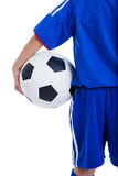 Back view of youth soccer player in blue uniform Royalty Free Stock Images