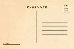 Back of vintage blank postcard. Isolate on white background royalty free stock photography
