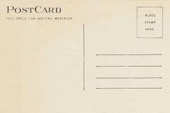 Back of vintage blank postcard. Isolate on white background stock photo