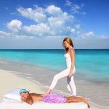 Back walking shiatsu massage Caribbean beach. Woman paradise landscape Stock Photo