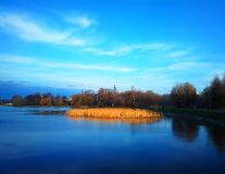 Back-water pond in sunset park background. Hd horizontal spacedrone808 orientation vivid vibrant bright color rich composition design concept element object stock images