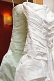 Back of Wedding Dress. That is hung in front of a mirror Royalty Free Stock Photos
