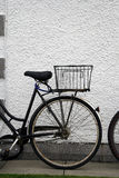 Back wheel. Of a ladies bike leaning against a white wall Royalty Free Stock Image