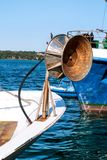 Back of a wheel on fishing boat with all its collected networks Stock Photography