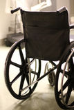 Back of wheelchair in a hospital. The back of a wheelchair in a hospital with blurred background Stock Photo