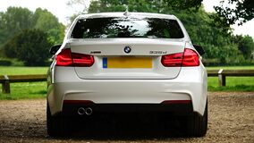 Back of white BMW Stock Image