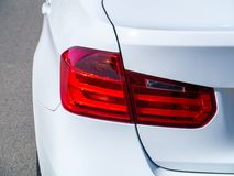 The back of a white car with royalty free stock images