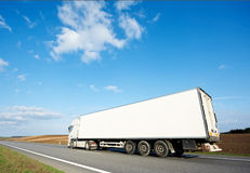 Back of white lorry trailer over blue sky Stock Photo