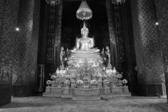 Back and white style image of golden Buddha statue and thai art architecture. Stock Photography