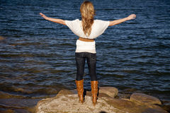 Back woman arms out water Stock Images