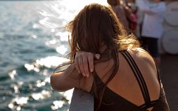 Back of woman on boat Royalty Free Stock Image