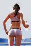 Back of woman with bottle royalty free stock photo