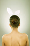 Back of a woman with bunny ears Stock Image