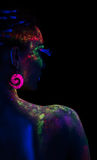 Back of woman in fluorescent paint makeup Stock Photos