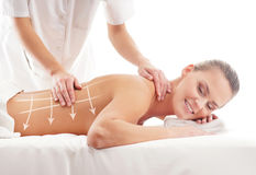 Back of a woman getting massaging treatment Stock Photography