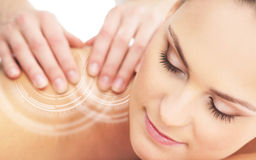 Back of a woman getting massaging treatment Royalty Free Stock Image