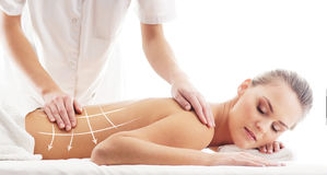 Back of a woman getting massaging treatment Stock Images