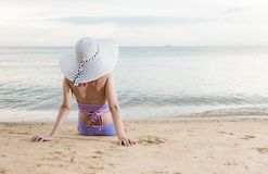 Back woman girl sitting  on tropical beach. Travel relaxation see sea view in vacation summer Royalty Free Stock Photos