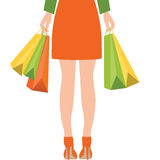 Back of woman holding shopping bags,Flat design. Stock Photos