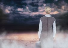 Back of Woman Looking at clouds Stock Images
