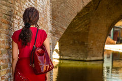 Back of woman in old Italian village Royalty Free Stock Image