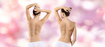 Back of woman on pink background Stock Photo