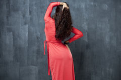 Back woman in red sexy dress Royalty Free Stock Photos